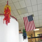 Hamlet Middle School students upcycle plastic, cardboard into chandeliers