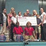 First Bank teaches kids about saving, donates $500 to Fairview Heights