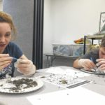 Richmond County 4-H campers pick through owl pellets