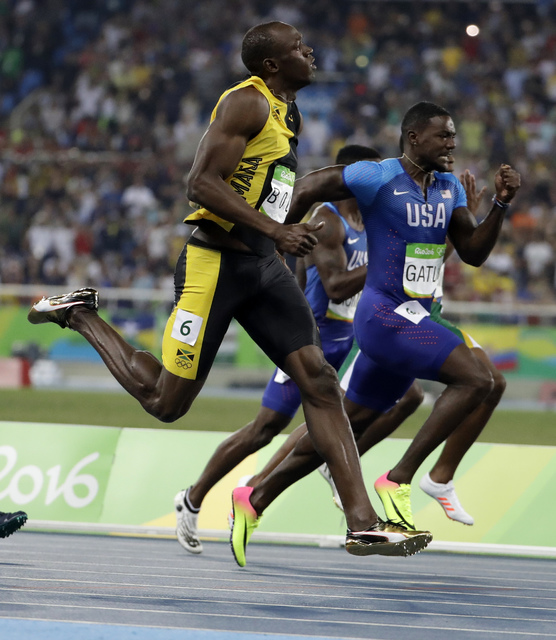 Rio 2016: Usain Bolt cruises to victory in Olympic 200m heats